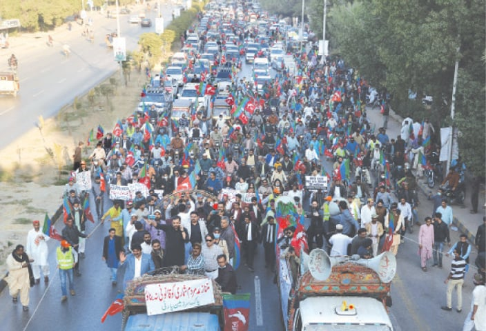PARTICIPANTS in the rally pass through Sharea Faisal on Sunday.—Photo by Shakil Adil / White Star