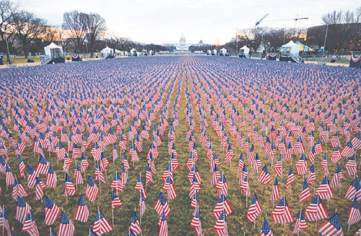 THOUSANDS of US flags flutter at Washington's National Mall as part of a tribute to US citizens who have died from the coronavirus disease.—Reuters
