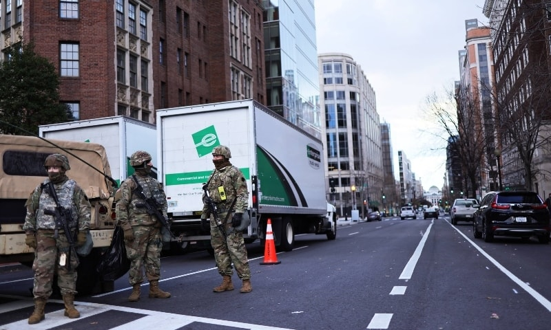 National Guard soldiers stand guard at a road block on January 18 in Washington. — AFP