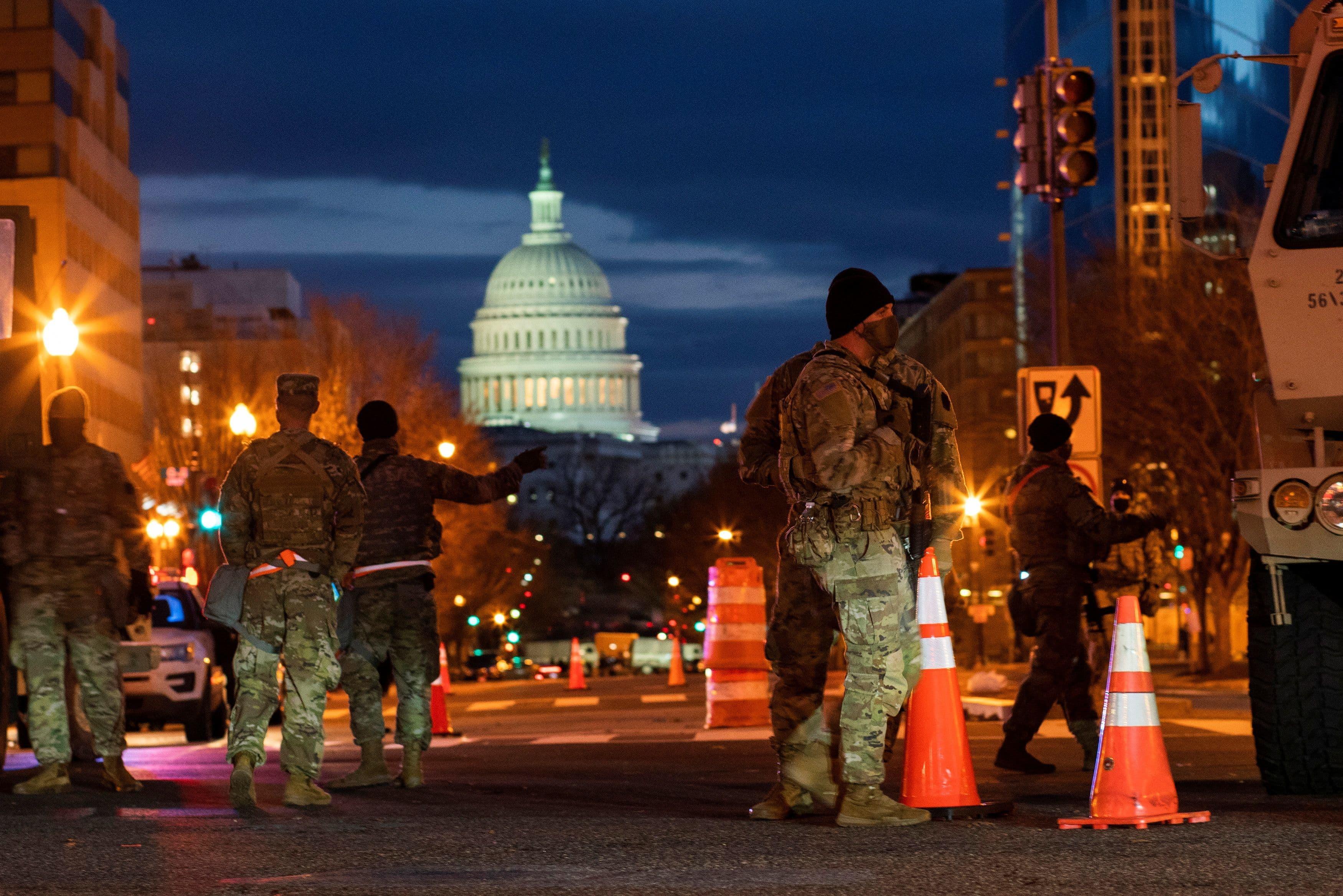 National Guard members get instructions near the Capitol, ahead of US President-elect Joe Biden's inauguration, in Washington, US, January 18, 2021. – Reuters