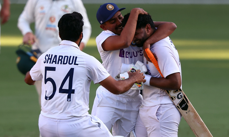India's batsman Rishabh Pant (R) celebrates victory with teammates in the fourth cricket Test match against Australia at The Gabba. — AFP