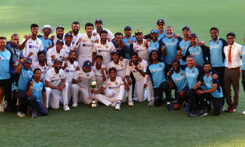 Indian players and officials celebrate with the winning trophy at the end of the fourth cricket Test match between Australia and India at The Gabba. — AFP
