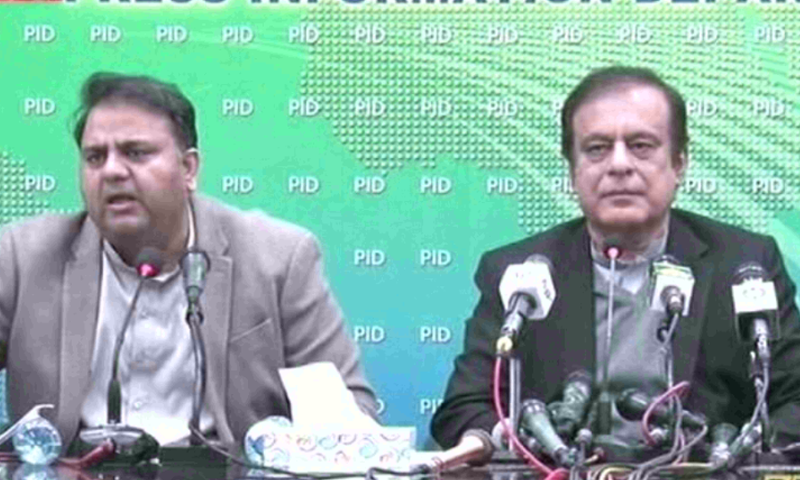 Minister for Science and Technology Fawad Chaudhry (left) and Information Minister Shibli Faraz address a press conference. — DawnNewsTV