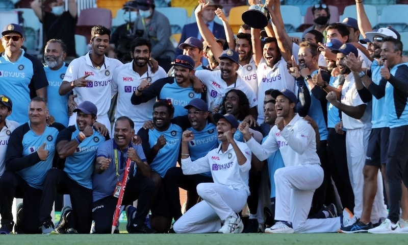 India's players and officials celebrate with the winning trophy at the end of the fourth cricket Test match between Australia and India at The Gabba in Brisbane on January 19. — AFP