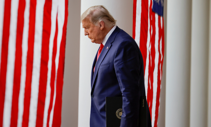 """US President Donald Trump walks down the West Wing colonnade from the Oval Office to the Rose Garden to deliver an update on the so-called """"Operation Warp Speed"""" programme, the joint Defence Department and HHS initiative that has struck deals with several drugmakers in an effort to help speed up the search for effective treatments for the ongoing Covid-19, at the White House in Washington, US on November 13, 2020. — Reuters/File"""