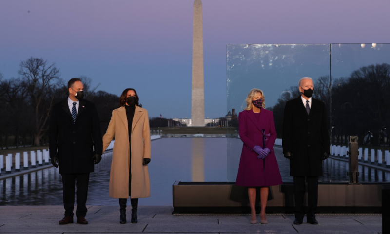 (L-R) Douglas Emhoff, US Vice President-elect Kamala Harris, Dr Jill Biden and US President-elect Joe Biden attend a memorial service to honor the nearly 400,000 American victims of the coronavirus pandemic at the Lincoln Memorial Reflecting Pool on January 19, 2021 in Washington, DC. — AFP