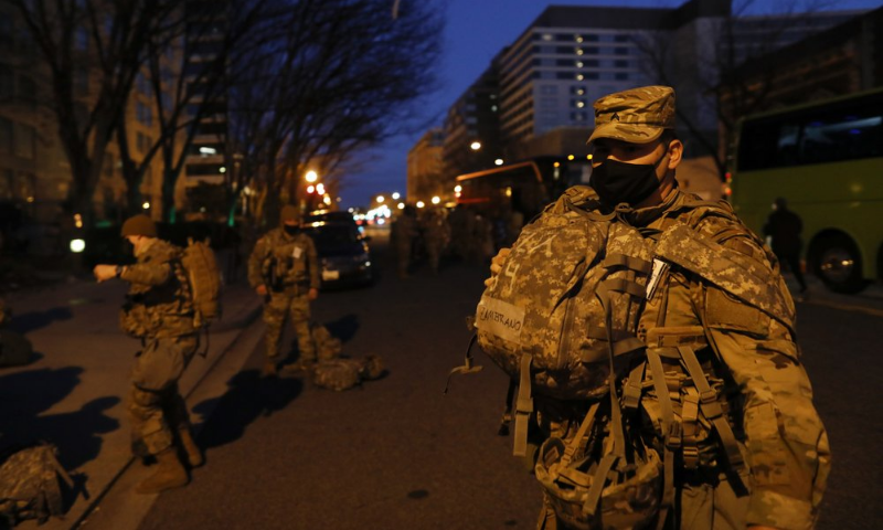 National Guard troops deploy near the Capitol at dawn in preparation for President-elect Joe Biden's inauguration ceremony on January 19, 2021, in Washington. — AP