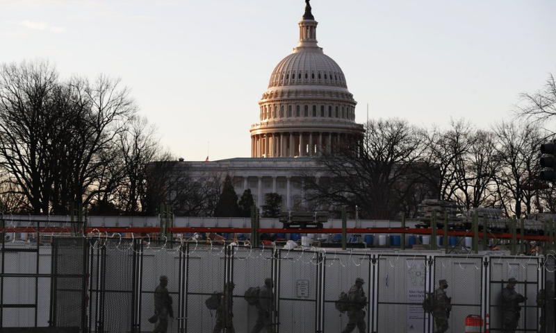 National Guards deploy inside the security perimeter surrounding the Capitol ahead of Biden's inauguration ceremony. — AP