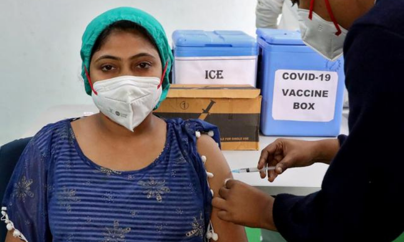 A healthcare worker receives a dose of Covishield, a Covid-19 vaccine manufactured by Serum Institute of India, at a government-run hospital at Baruipur on the outskirts of Kolkata, India on  January 18. — Reuters