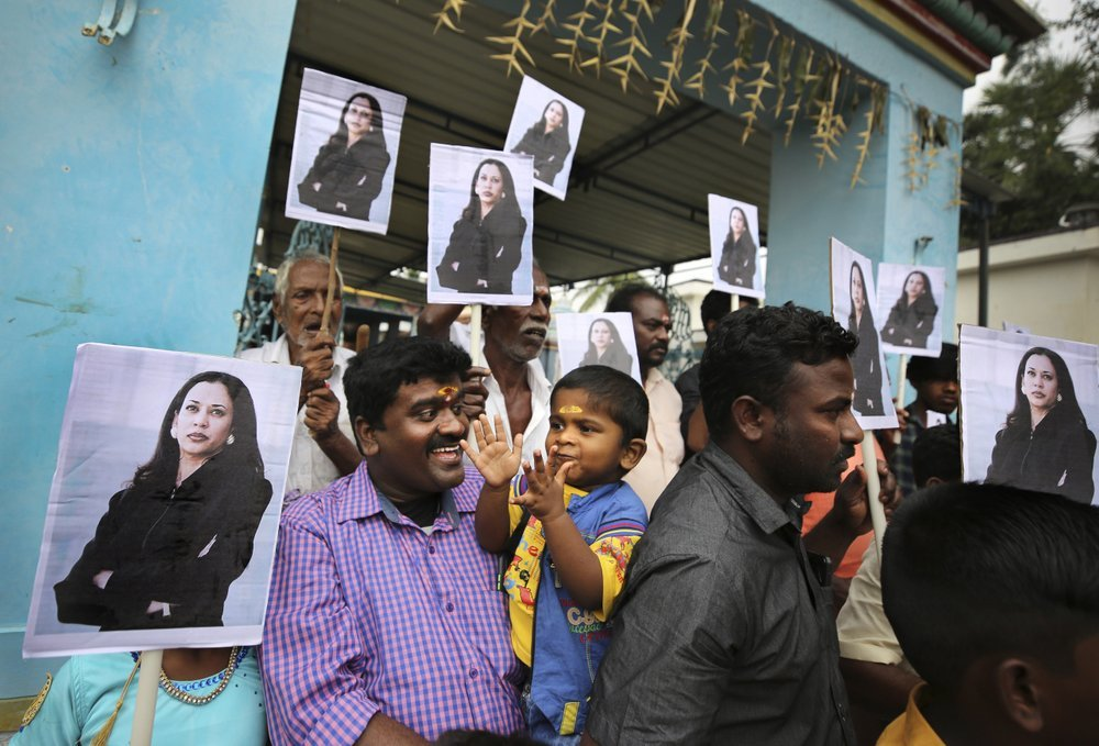 A child reacts as villagers hold placards featuring Kamala Harris after participating in special prayers ahead of her inauguration, outside a Hindu temple in Thulasendrapuram, the hometown of Harris' maternal grandfather, south of Chennai, Tamil Nadu state, India, on Jan 20. All photos by AP