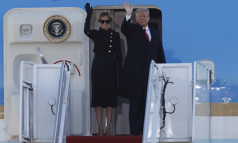 United States President Donald Trump and first lady Melania Trump wave to a crowd as they board Air Force One at Andrews Air Force Base on Wednesday. — AP