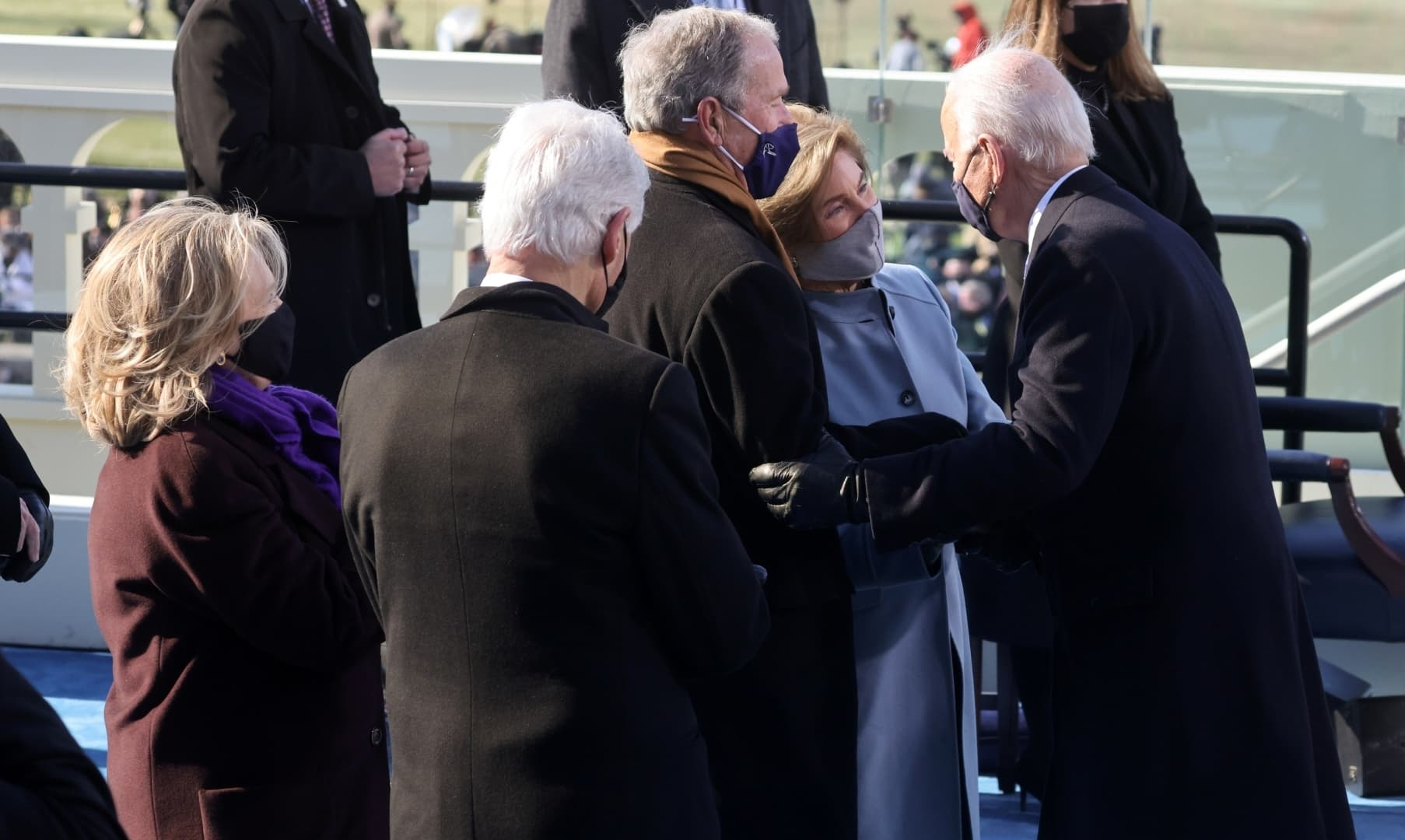 US President Joe Biden greets former US president George W. Bush and his wife Laura Bush, and former president Bill Clinton and his wife Hillary Clinton at his inauguration at the US Capitol in Washington. — Reuters