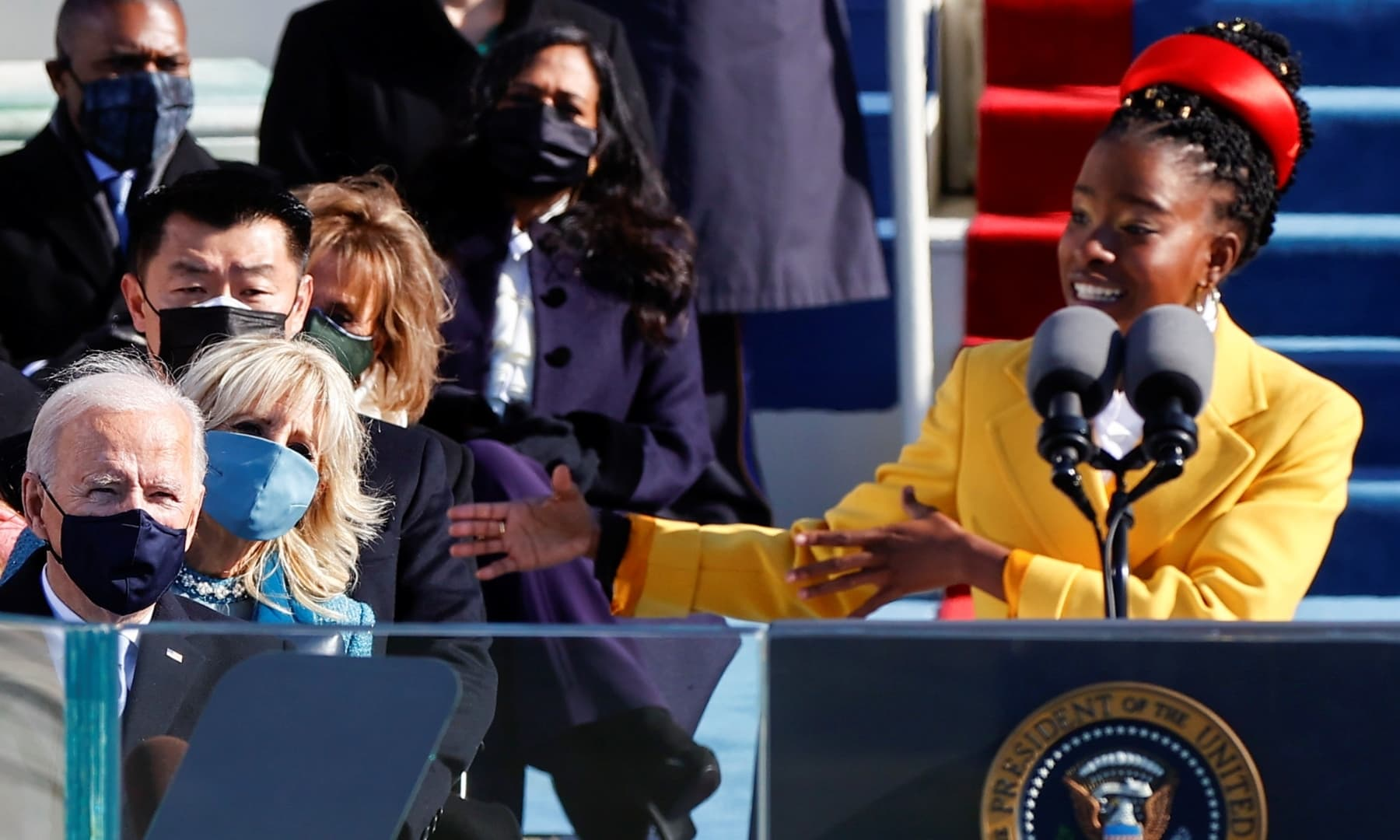 US President Joe Biden listens as Amanda Gorman recites a poem during his inauguration on the West Front of the US Capitol in Washington. — Reuters