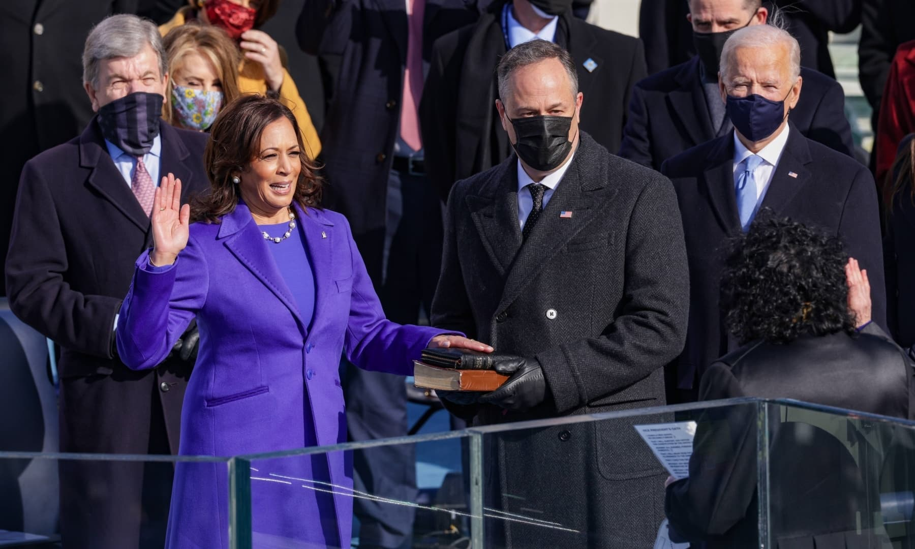 Kamala Harris is sworn is as US Vice President as her husband Doug Emhoff looks at the US Capitol on January 20 in Washington, DC. — AFP