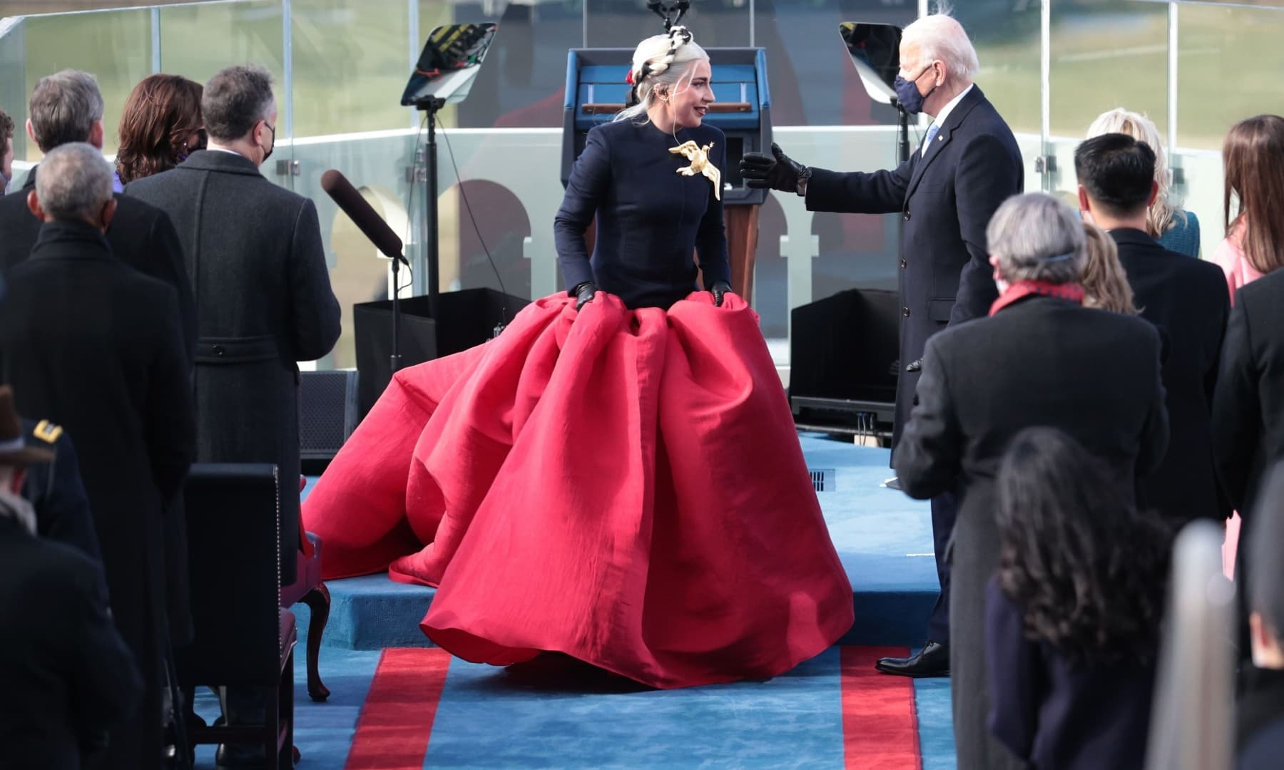 Lady Gaga talks with US President-elect Joe Biden during his inauguration on the West Front of the US Capitol on January 20 in Washington, DC. — AFP