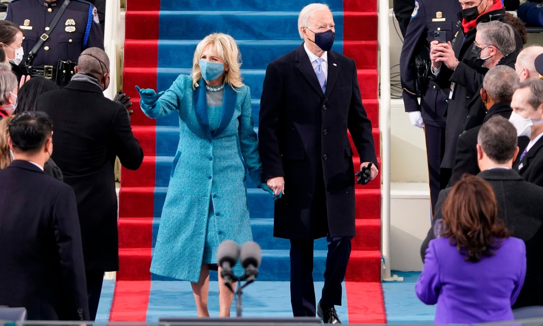 US President-elect Joe Biden flanked by wife Dr Jill Biden arriving for his inauguration as the 46th US President on January 20 at the US Capitol in Washington, DC. — AFP
