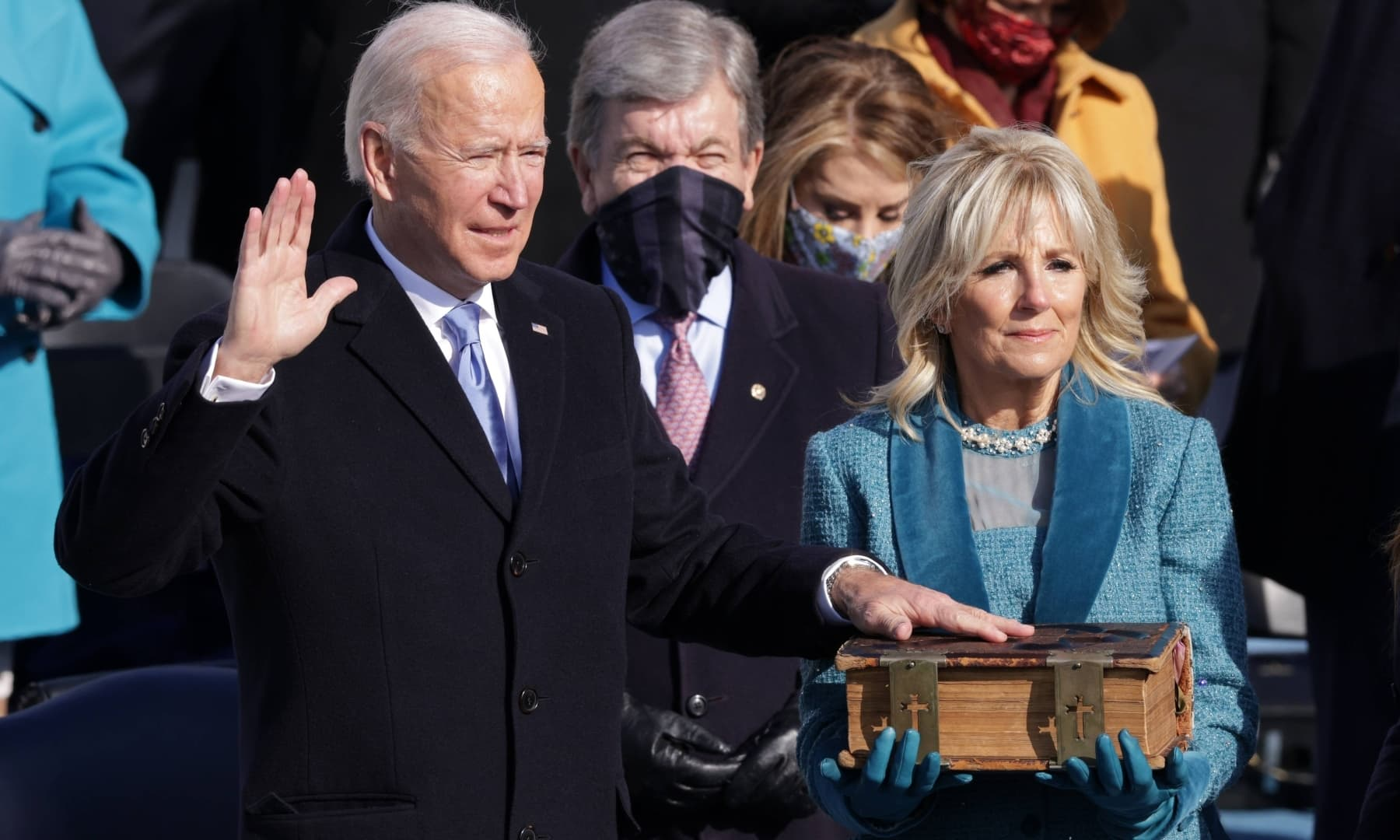 Joe Biden is sworn in as US President as his wife Dr Jill Biden looks on during his inauguration on the West Front of the US Capitol on January 20 in Washington, DC. — AFP