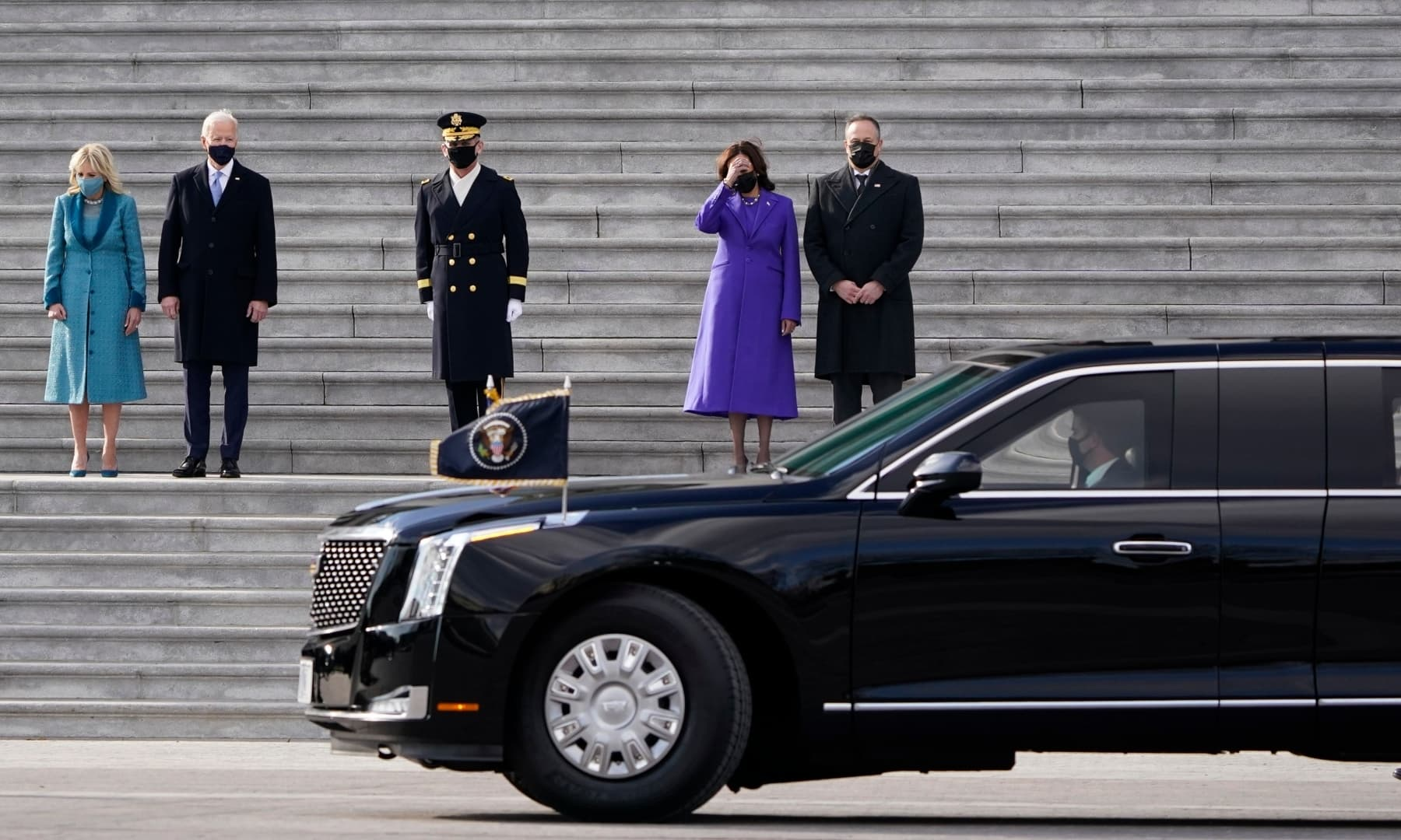 President Joe Biden, his wife Jill Biden, Vice President Kamala Harris and her husband Doug Emhoff prepare to depart the East Front of the Capitol at the conclusion of the inauguration ceremonies, in Washington, Wednesday. — AP