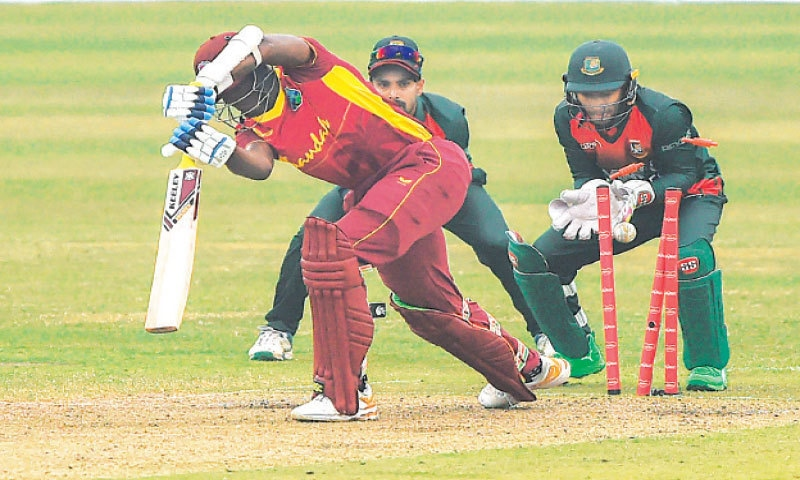 WEST INDIES' Alzarri Joseph is cleaned up by Bangladesh spinner Shakib Al Hasan during the first One-day International at the Sher-e-Bangla National Stadium on Wednesday.—AFP