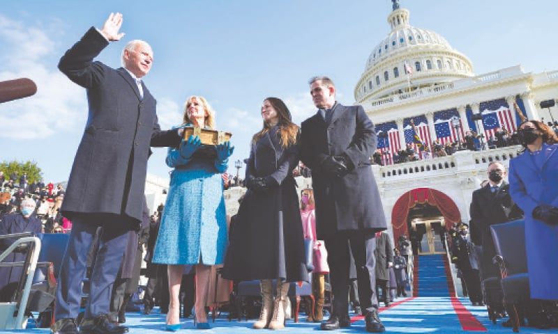 WASHINGTON: Joe Biden is sworn in as the 46th president of the United States by Chief Justice John Roberts at the US Capitol on Wednesday. Jill Biden holds the Bible.—AP