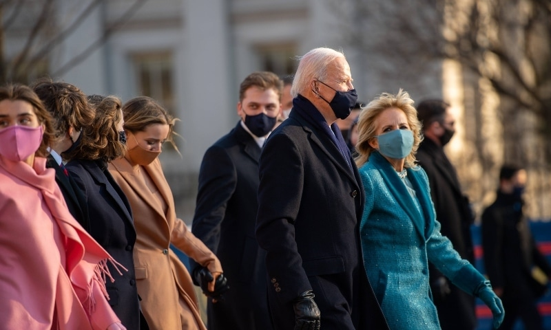 US President Joe Biden, First Lady Dr. Jill Biden and family walk the abbreviated parade route after Biden's inauguration on January 20. —  AFP