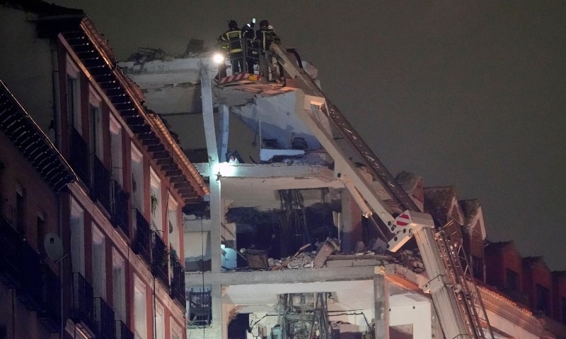 Firefighters work after a deadly explosion at a building belonging to the Catholic Church in Madrid on Jan 20. — Reuters