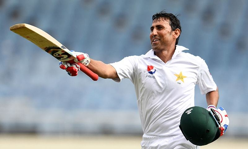 Pakistan's batsman Younis Khan celebrates after reaching his 10,000th run in Test matches, on day three of the first Test match between West Indies and Pakistan at the Sabina Park in Kingston, Jamaica, on April 23, 2017. — AFP/File