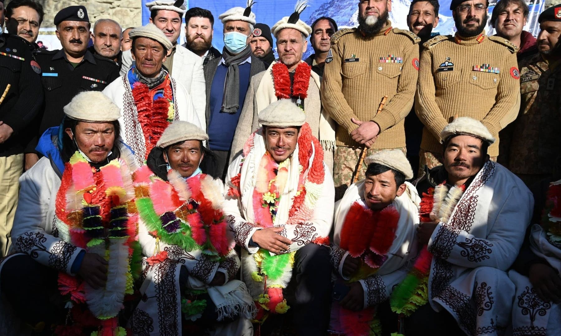 Nepal's climbers pose for a photograph with Pakistani officials while attending a welcome ceremony upon their arrival after becoming the first to summit Pakistan's K2 in winter, at Shigar district in Gilgit-Baltistan, Jan 20, 2021. — AFP