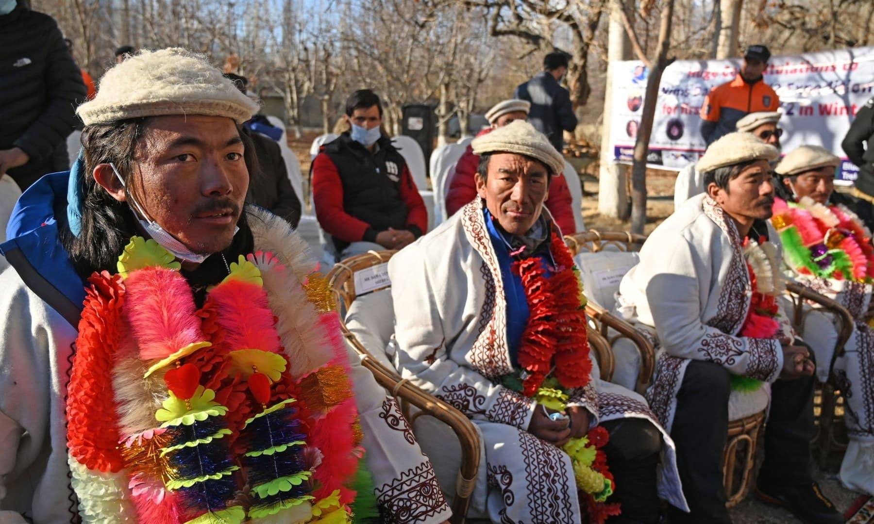 Nepal's climber Mingma Sherpa (L) attends a welcome ceremony with teammates upon their arrival after becoming the first to summit Pakistan's K2 in winter, at Shigar district in Gilgit-Baltistan, Jan 20, 2021. — AFP