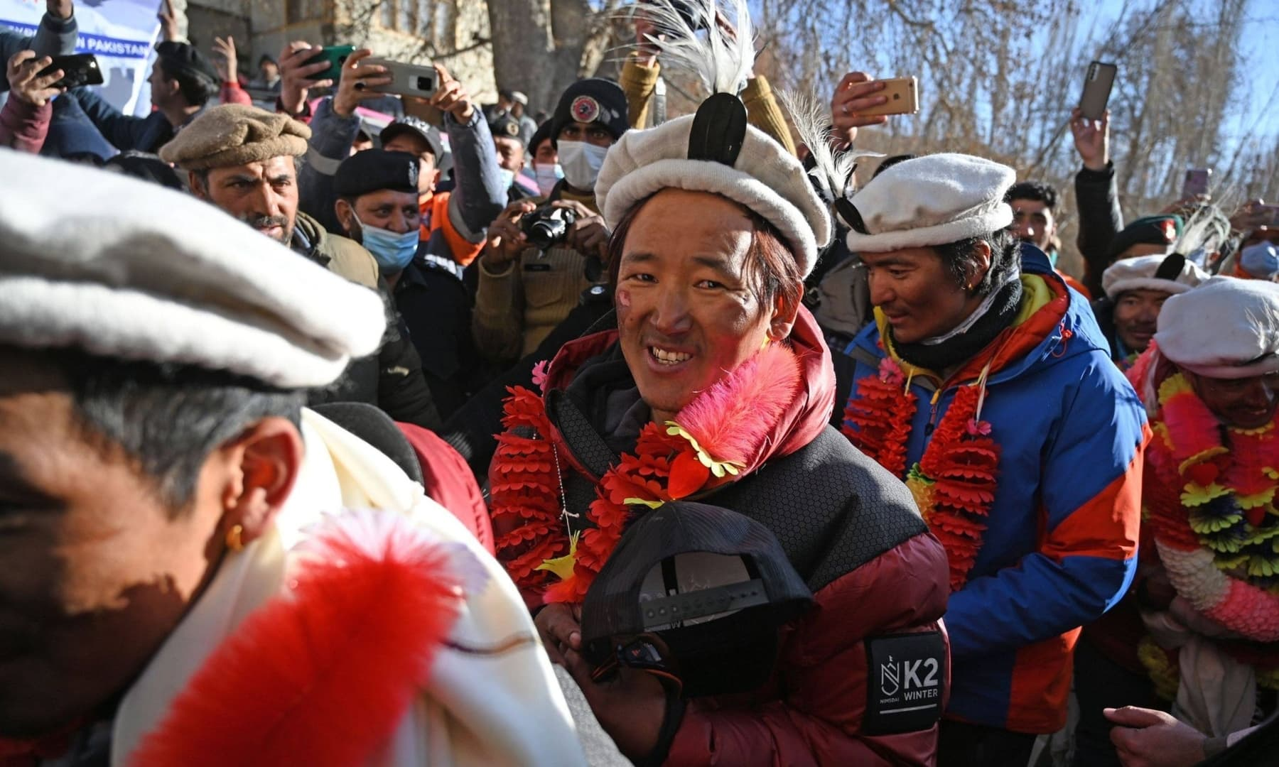 People garland Nepal's climbers during a welcome ceremony upon their arrival after becoming the first to summit Pakistan's K2 in winter, at Shigar district in Gilgit-Baltistan, Jan 20, 2021. — AFP