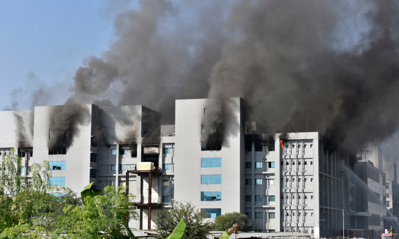 Smoke rises after a fire broke out at India's Serum Institute in Pune on Thursday. — AFP