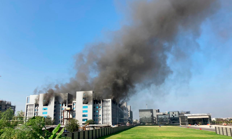 Smoke rises from the Serum Institute of India, the world's largest vaccine maker that is manufacturing the AstraZeneca/Oxford University vaccine for the coronavirus, in Pune, India on Thursday. — AP