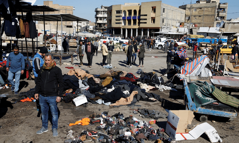 The site of a twin suicide bombing attack in a central market is seen in Baghdad, Iraq on Thursday. — Reuters