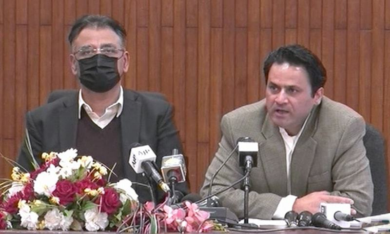 Federal minister Asad Umar and special assistant Tabish Gauhar address a press conference in Islamabad. — DawnNewsTV