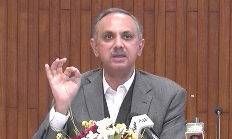 Minister for Energy Omar Ayub Khan addresses a press conference. — DawnNewsTV