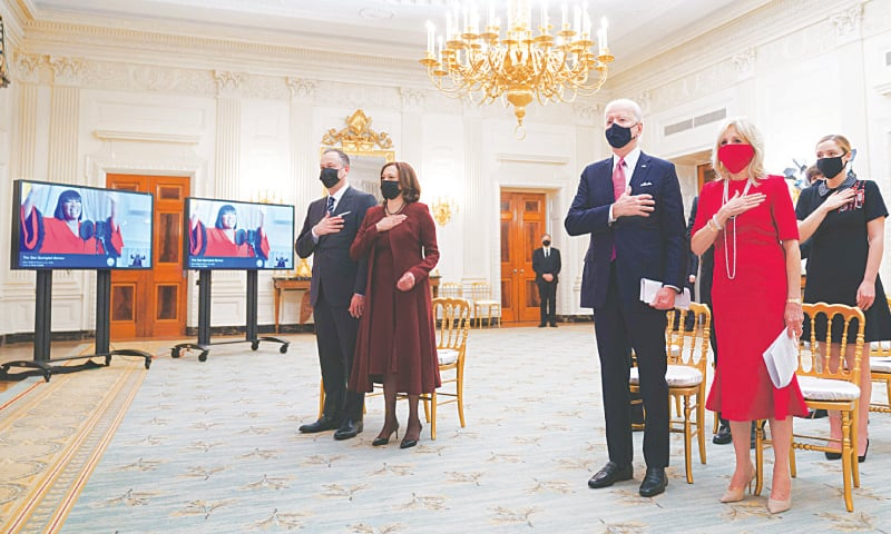 WASHINGTON: US President Joe Biden, First Lady Jill Biden (second right), Vice President Kamala Harris (second left) and her husband Doug Emhoff watch the virtual Presidential Inaugural Prayer Service hosted by the Washington National Cathedral in the State Dining Room of the White House on Thursday.—AFP