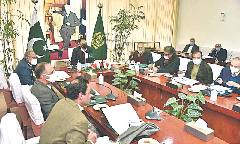 ISLAMABAD: Federal Minister for Planning, Development, Reforms and Special Initiatives Asad Umar chairing a meeting of the Cabinet Committee on Energy at the Cabinet Division on Thursday.—APP