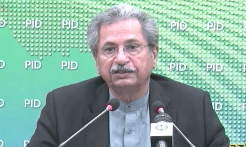 Federal Minister for Education and Professional Training Shafqat Mahmood addresses a press conference on civil service reforms. — DawnNewsTV/File