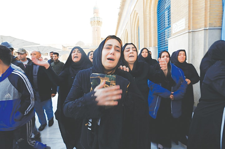 BAGHDAD: Women mourn during funeral at the shrine of Sheikh Abdul Qadir Jeelani of a man who was killed in a suicide attack on Thursday. Thirty-two persons were killed in the attack.—Reuters