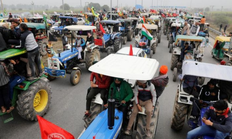 Farmers participate in a tractor rally to protest against the newly passed farm bills, on a highway on the outskirts of New Delhi, India, January 7, 2021. — Reuters