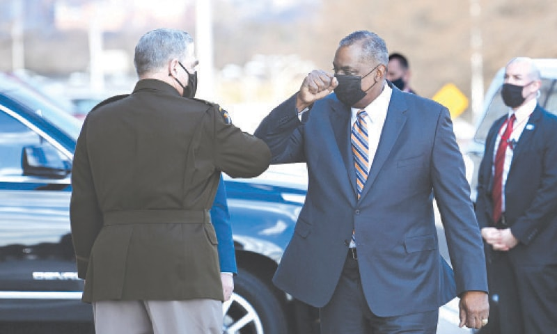 WASHINGTON: Incoming US Defence Secretary  Lloyd Austin (right) greets Chairman of the Joint Chiefs of Staff Mark Milley after the former arrived at the Pentagon on Friday.—AFP