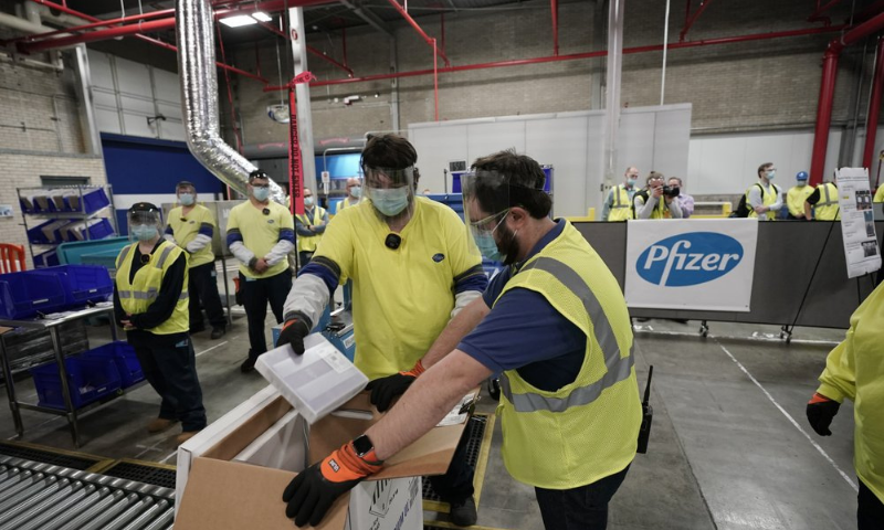 In this Dec 13, 2020 file photo, boxes containing the Pfizer-BioNTech Covid-19 vaccine are prepared to be shipped at the Pfizer Global Supply Kalamazoo manufacturing plant in Portage, US. — AP