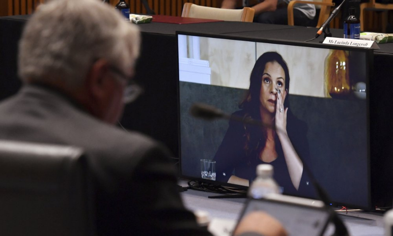 Mel Silva, right, the managing director of Google Australia and New Zealand, appears via a video link during a Senate inquiry into a mandatory code of conduct proposed by the government at Parliament House in Canberra on Friday. — AP