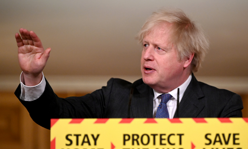 British Prime Minister Boris Johnson gestures as he speaks during a coronavirus news conference at 10 Downing Street, London, Britain on Friday. — Reuters