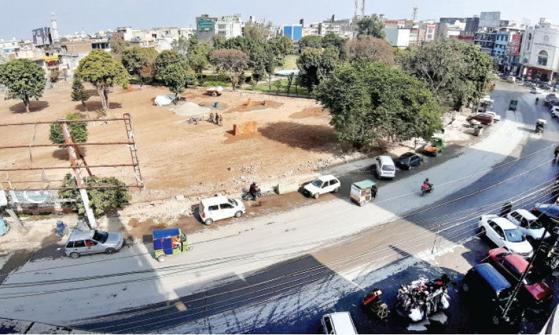 Work underway on a parking lot in Commercial Market in Rawalpindi. — White Star