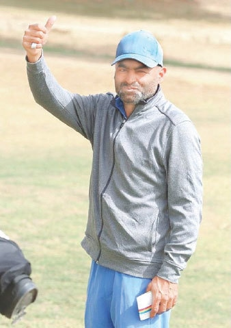 SHABBIR Iqbal gives a thumbs up at the end of the second round of the Sindh Open on Saturday.