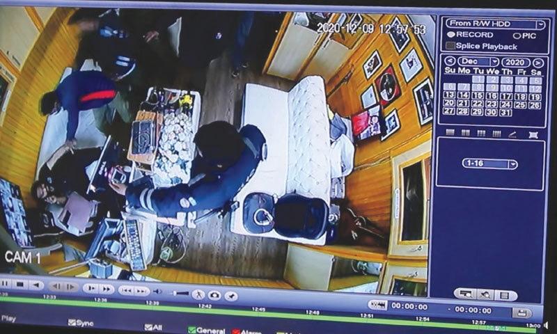 Still from CCTV cameras during the police raid on DJ Butt's office