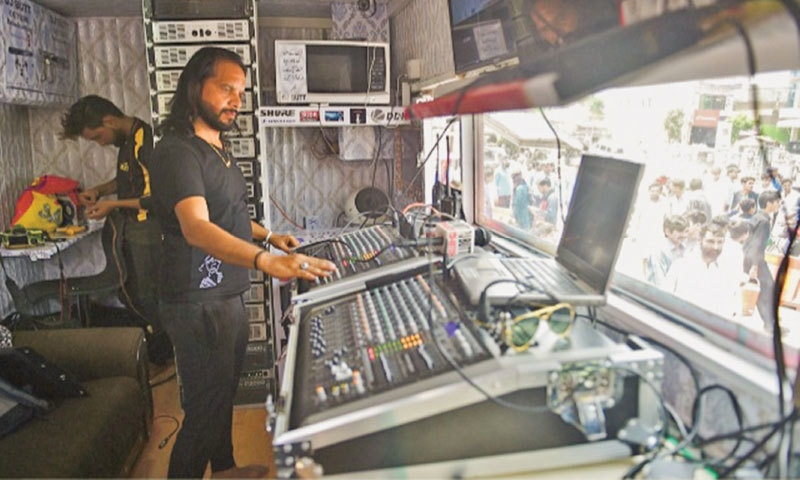 Asif Nazar Butt, better known by his stage persona DJ Butt, coordinates the music during a rally of the Pakistan Peoples Party (PPP) in Islamabad | AFP