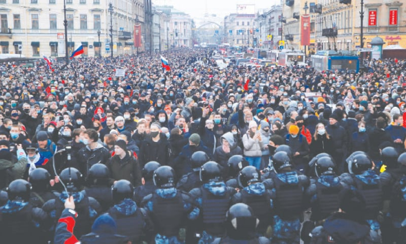 Law enforcement officers stand in front of participants during a rally in support of jailed Russian opposition leader Alexei Navalny in Saint Petersburg on Saturday.—Reuters