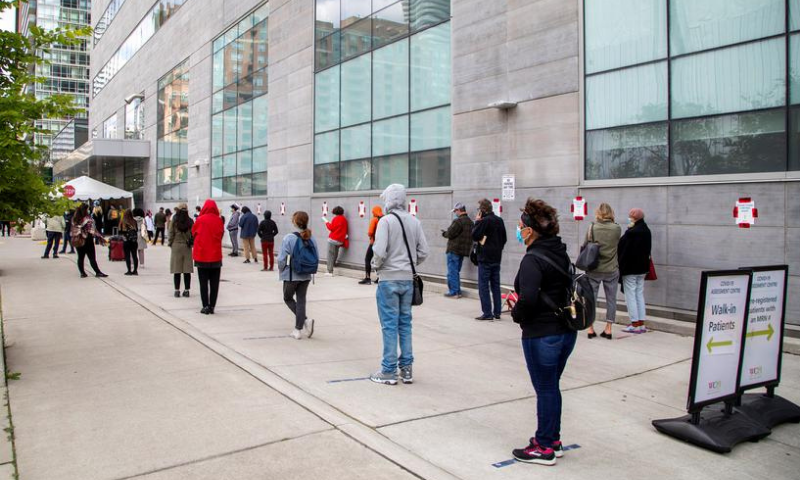 People wait in line at the Women's College coronavirus  testing facility in Toronto, Ontario, Canada in this file photo. — Reuters